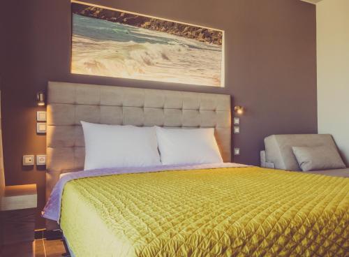 Ένα ή περισσότερα κρεβάτια σε δωμάτιο στο Paspalis Hotel