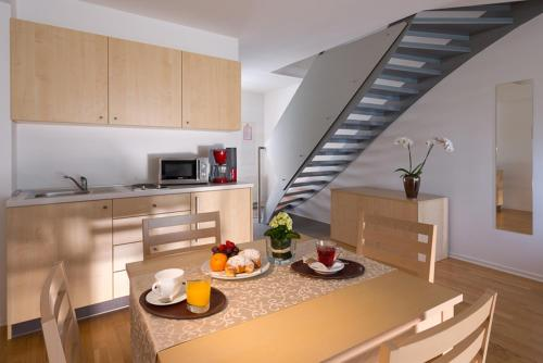 A kitchen or kitchenette at Postojna Cave Rooms & Apartments Proteus