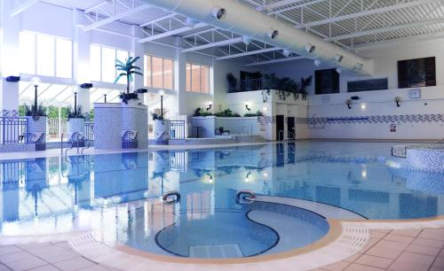 The swimming pool at or near Village Hotel Manchester Bury