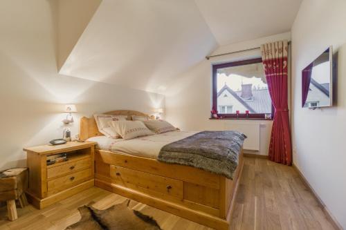 Łóżko lub łóżka w pokoju w obiekcie Apartament Montagne