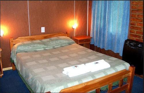 Una cama o camas en una habitación de Complejo Los Arrayanes