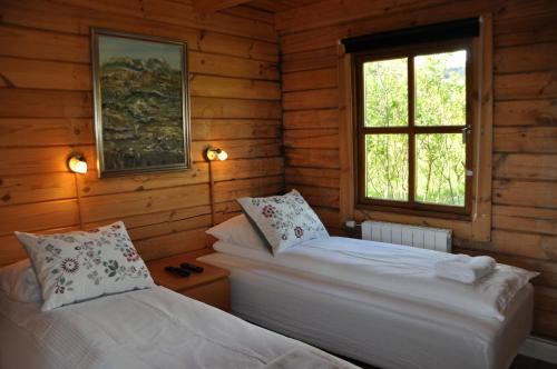 A bed or beds in a room at North Star Cottage