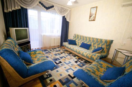 Гостиная зона в Comfort Apartments