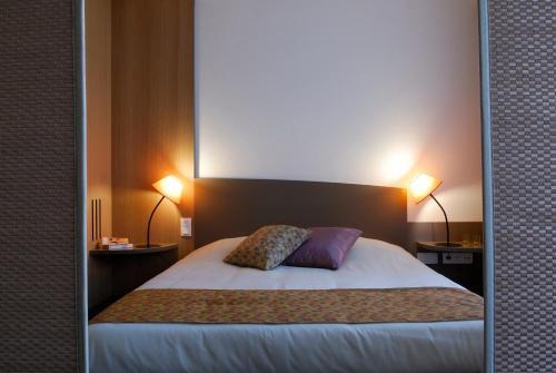 Кровать или кровати в номере Aparthotel Adagio Bordeaux Centre Gambetta