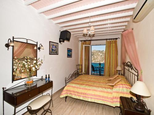 Ένα ή περισσότερα κρεβάτια σε δωμάτιο στο Vana Holidays