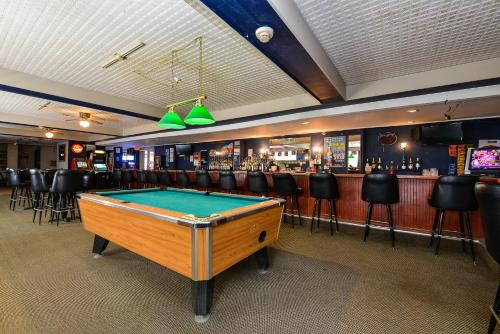 A pool table at Americas Best Value Inn Cleveland Airport