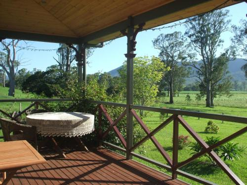 A balcony or terrace at Feathers Home Stay