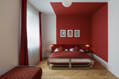 Un ou plusieurs lits dans un hébergement de l'établissement AXA Hotel