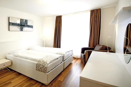 Ein Bett oder Betten in einem Zimmer der Unterkunft Luxury Apartments by Livingdowntown