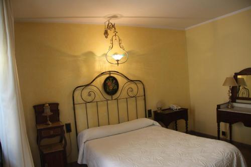 Кровать или кровати в номере Fonda Sala