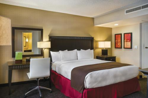 A bed or beds in a room at Doubletree by Hilton Los Angeles Downtown