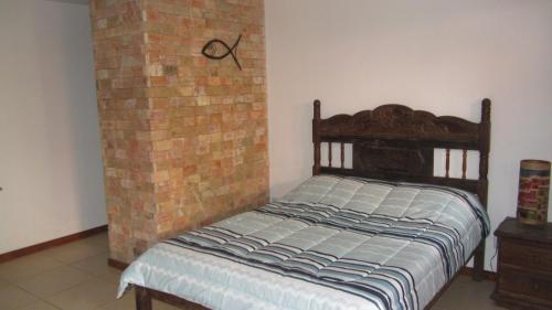 A bed or beds in a room at A casa do vizinho