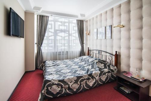 A bed or beds in a room at Express Hotel&Hostel