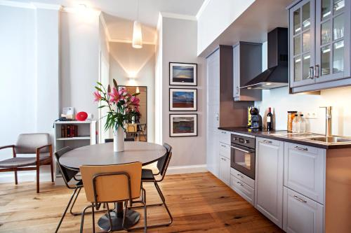 A kitchen or kitchenette at Reykjavik Residence Apartment Hotel