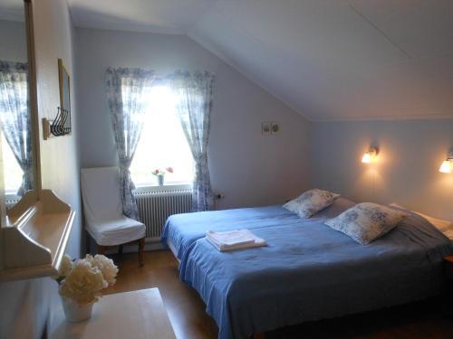 Säng eller sängar i ett rum på Jordhammars Herrgård SVIF Vandrarhem