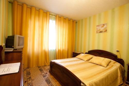 Кровать или кровати в номере Comfort Apartments