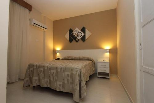 A bed or beds in a room at Gonzaga Flat (Technotel Ltda.)