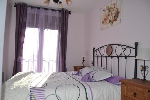 Cama o camas de una habitación en Casa Rural El Dolmen