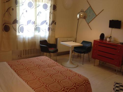 A bed or beds in a room at Casa Olivia