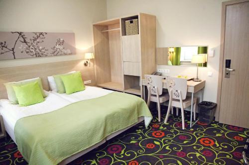 Letto o letti in una camera di City Hotels Rūdninkai