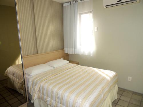 A bed or beds in a room at Apartamento Ponta Verde Maceio