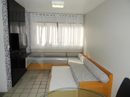 A seating area at Apartamento Ponta Verde Maceio