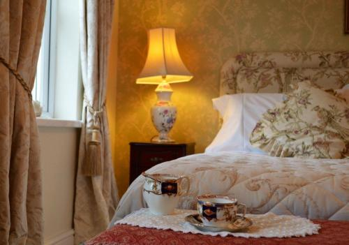 A bed or beds in a room at Killyliss Country House B&B