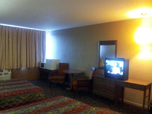 A television and/or entertainment center at Indian Head Motel