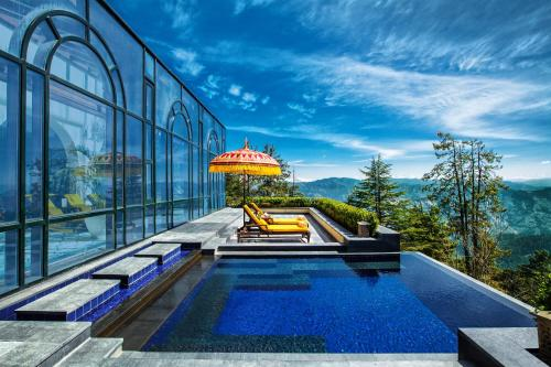 The swimming pool at or close to Wildflower Hall, An Oberoi Resort, Shimla