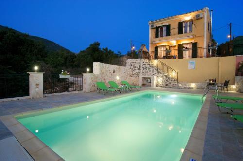 The swimming pool at or near Villa Chrisanthi