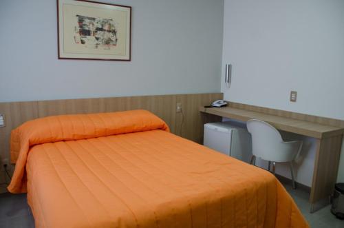 Cama ou camas em um quarto em Frimas Pampulha Hotel