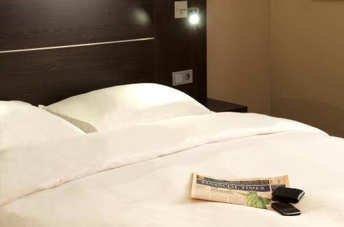 A bed or beds in a room at Mercure Hotel Hamm