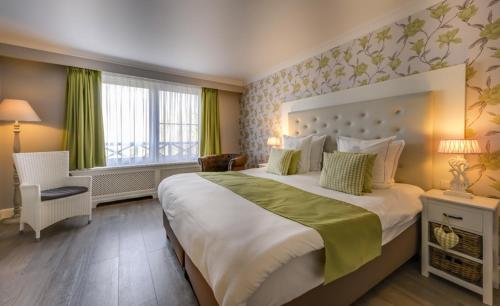 Un ou plusieurs lits dans un hébergement de l'établissement Ara Dune Hotel