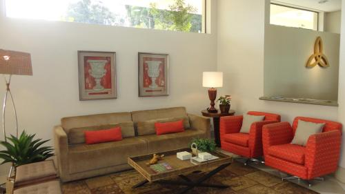 Uma área de estar em Serra Negra Palace Hotel