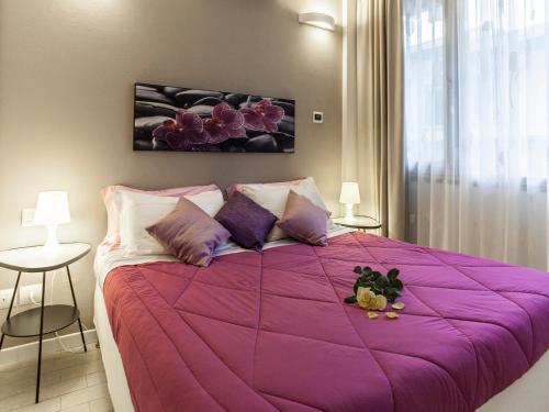A bed or beds in a room at La Farina Apartments