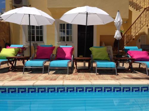 The swimming pool at or near Casa Paula Apartments