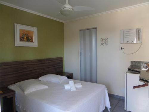 Cama ou camas em um quarto em Pousada Mariá