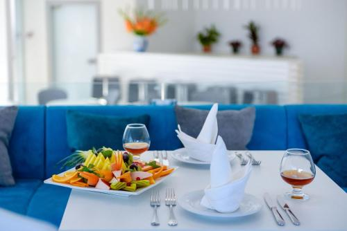 A restaurant or other place to eat at Boutique Hotel Adriano