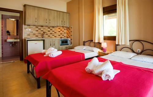 A bed or beds in a room at Livari Studios