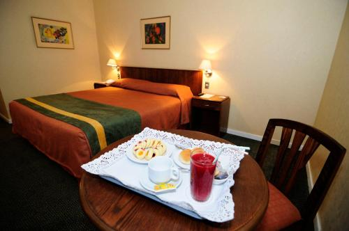 Cama o camas de una habitación en Hotel Diego De Almagro Calama