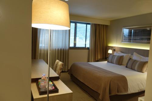 Cama o camas de una habitación en Hotel Los Españoles Plus