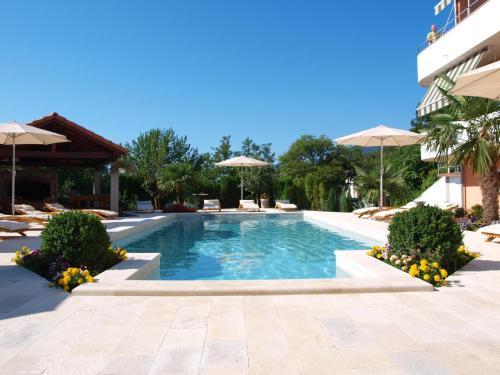 The swimming pool at or near Apartments Villa Učka
