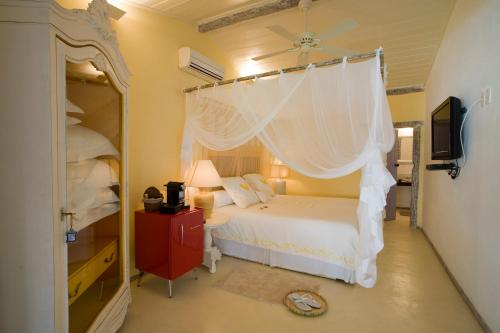 A bed or beds in a room at Pousada Bendito Seja