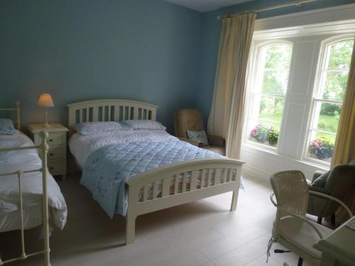 A bed or beds in a room at Riversdale Country House