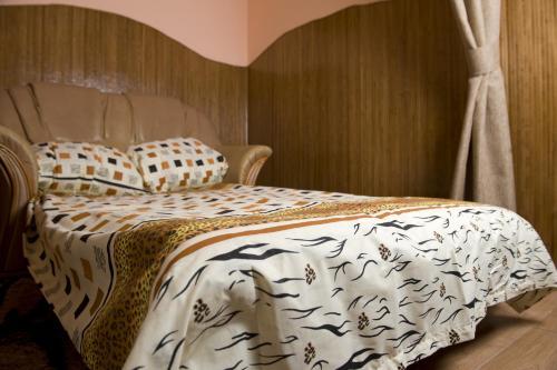 Ein Bett oder Betten in einem Zimmer der Unterkunft Lviv Centre Apartment