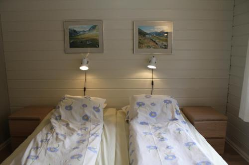 A bed or beds in a room at Jostedal Hotel