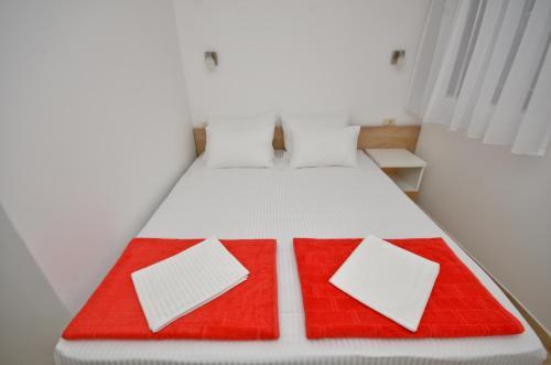 Кровать или кровати в номере Gospostina Apartment