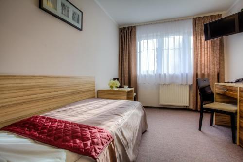 Postel nebo postele na pokoji v ubytování Hotel Alpex
