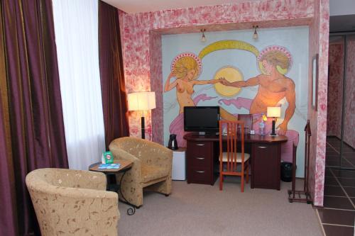 Телевизор и/или развлекательный центр в Beerloga Hotel