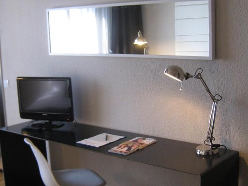 A television and/or entertainment center at Sercotel Leyre